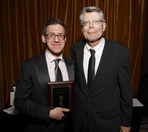Accepting the Ellery Queen Award from Stephen King, 2015