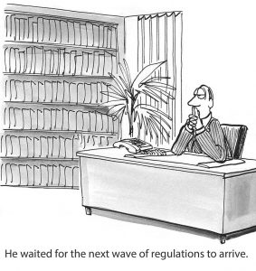 "Cartoon: man sitting at desk with caption ""he waited for the next wave of regulations to arrive."""